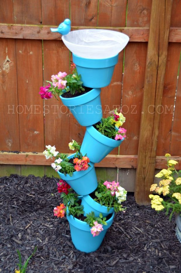 Topsy turvey planter made out of terracotta pots.